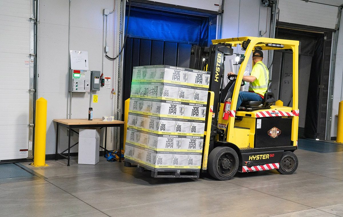Man Riding On Yellow Forklift 1267329